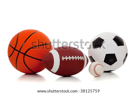An assortment of sports balls including basketball, american football, soccer ball and baseball on a white background - stock photo