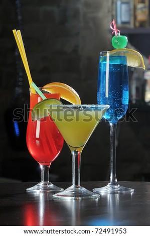 An assortment of various alcoholic drinks on a bar. - stock photo