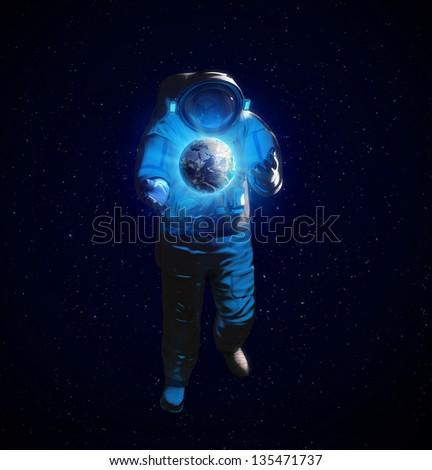 An astronaut in space in a state of weightlessness - stock photo
