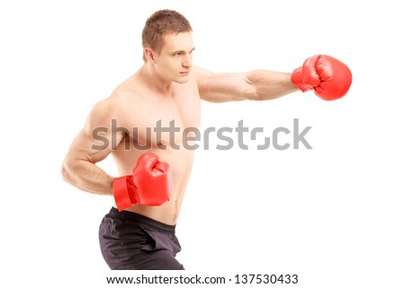 An athlete with boxing gloves, isolated on white background - stock photo