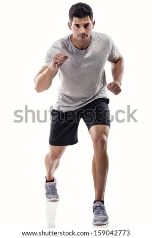 An athletic man running, isolated over a white background - stock photo