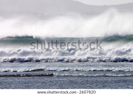 An atlantic wave breaking as it reached the shore. - stock photo