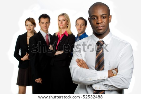 An attractive african american businessman and his team of professionals standing together on white background - stock photo