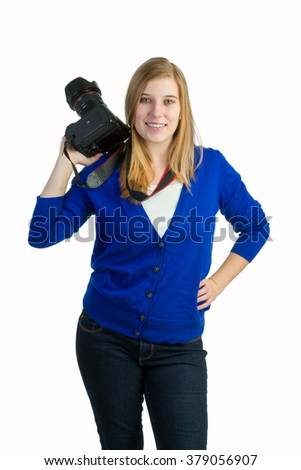 An attractive blond woman with a camera - stock photo