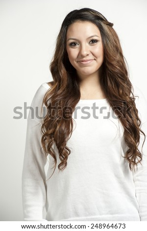 An attractive brunette young girl posing on a white background in a studio. - stock photo