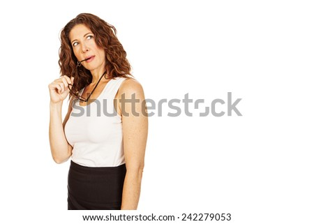 An attractive business woman holding a pair of eyeglasses and looking up with a thinking expression. - stock photo