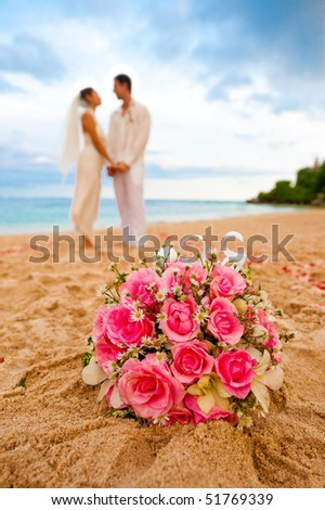 An attractive caucasian couple getting married by the beach - stock photo