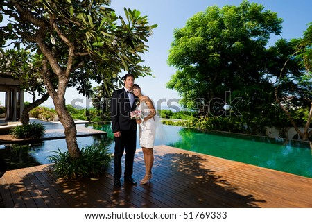 An attractive caucasian couple getting married outdoors - stock photo