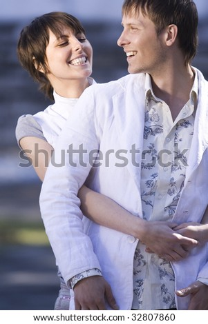 An attractive couple playing around in park - stock photo