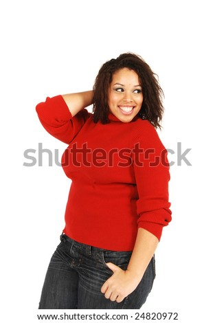 An attractive full figured model in a red sweater. - stock photo