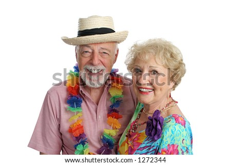 An attractive mature couple enjoying their second honeymoon on a tropical vacation. - stock photo