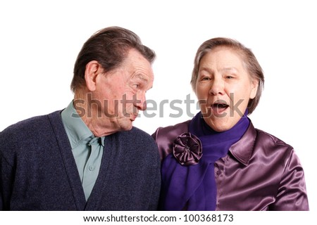 an attractive senior couple on a white background - stock photo