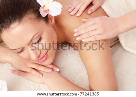 An attractive woman getting spa treatment - stock photo