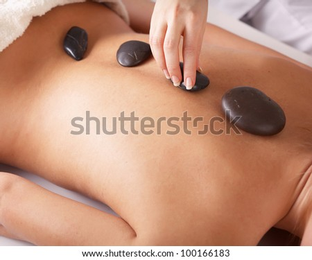 An attractive woman getting spa treatment, isolated on white - stock photo
