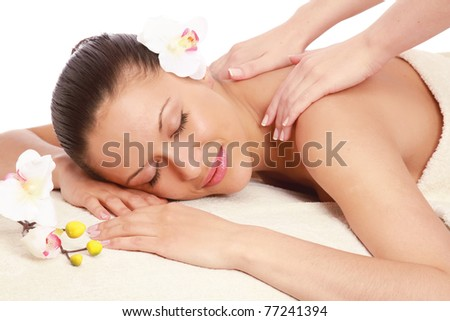 An attractive woman getting spa treatment isolated on white - stock photo