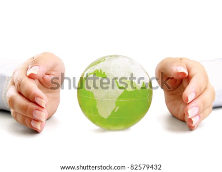 An attractive woman holding a glass globe - stock photo