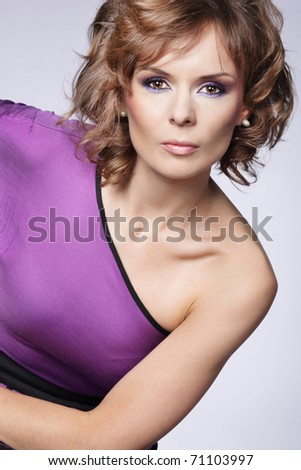 An attractive  woman posing in a pink dress. - stock photo