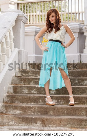 An attractive woman posing outside in a park - stock photo