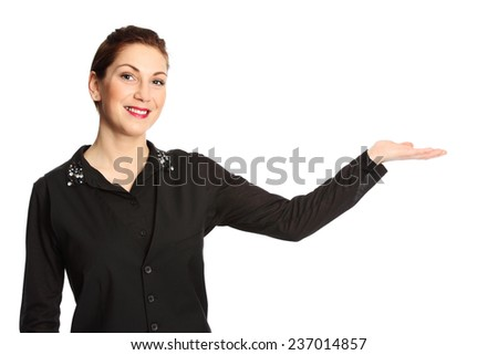 An attractive woman wearing a black shirt with red lipstick standing in front of a white background, gesturing. - stock photo