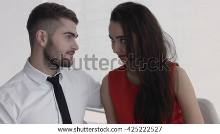 An attractive young couple enjoying each other's company over lunch  - stock photo