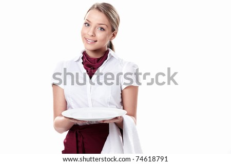An attractive young waitress holding an empty plate on a white background - stock photo