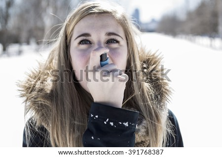 An Attractive young woman in wintertime outdoor - stock photo