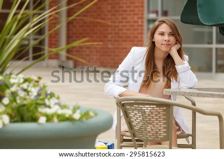 An attractive young woman with a white blazer - stock photo