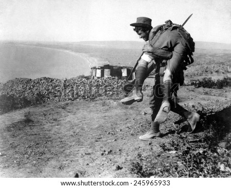 An Australian soldier carrying a wounded comrade during the WWI, Dardanelles Campaign. 1915. - stock photo