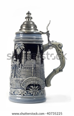 an authentic german beer stein isolated on a white background - stock photo