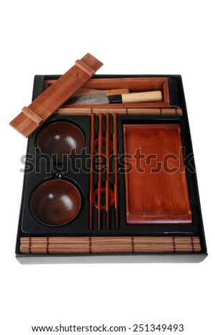An authentic Sushi Making Kit, Complete with Knife, Chop Sticks, Rice Bowls, Rolling Bamboo Mat, Forming Frame, Presentation Plate, Instructions and more. Sushi is made from Raw Fish and Rice  - stock photo
