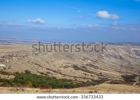 An autumn valley with blue sky