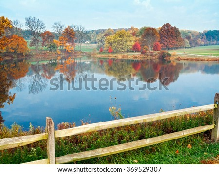 An Autumn view of the pond in Holmdel Park in Monmouth County New Jersey. - stock photo