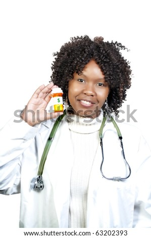 An doctor holding a bottle of prescription medication - stock photo