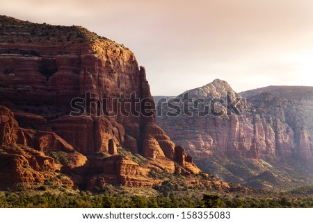 An early morning sunrise Illuminates these amazing Sedona Arizona Red Rock Formations - stock photo