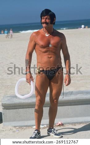 An eccentric senior citizen in a swimming suit, Venice Beach, CA - stock photo