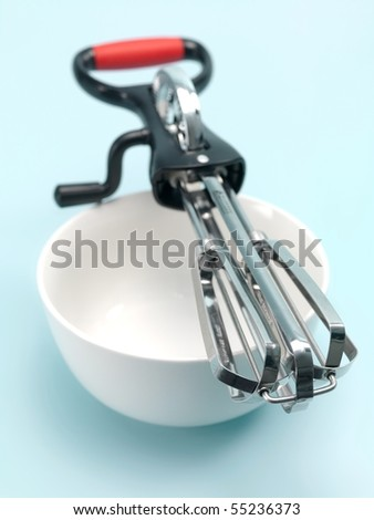 An egg beater on a kitchen bench - stock photo