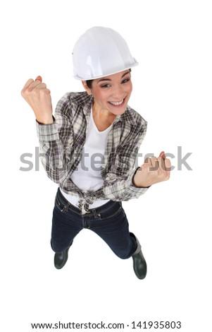 An elated tradeswoman - stock photo
