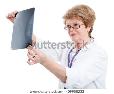 An elder Caucasian female doctor looking an X-ray image, isolated on white background - stock photo