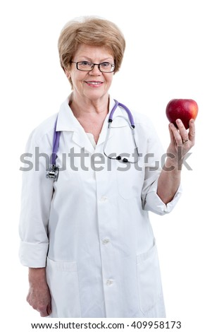 An elder doctor dietician showing red big apple in hand, isolated on white background - stock photo
