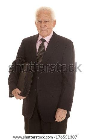 An elderly business man standing in a suit. - stock photo