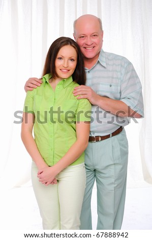 An elderly father and daughter together. Symbol of the family. - stock photo