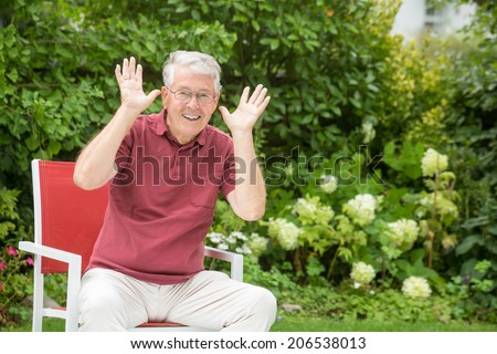 An elderly man is going crazy - stock photo