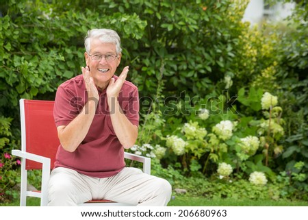 An elderly man is smiling and having fun - stock photo