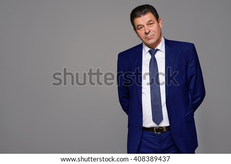 an elderly man model on a gray background, studio - stock photo