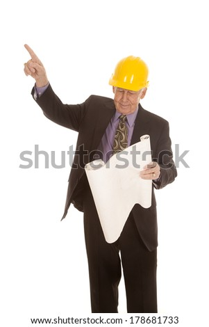 An elderly man pointing up to the sky holding on to his plans. - stock photo