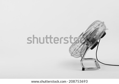 An electric fan isolated on white - stock photo