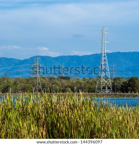 An Electrical pylon or tower carries high voltage lines - stock photo