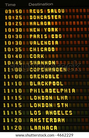 An electronic airport airplane departures board with times and destinations. - stock photo