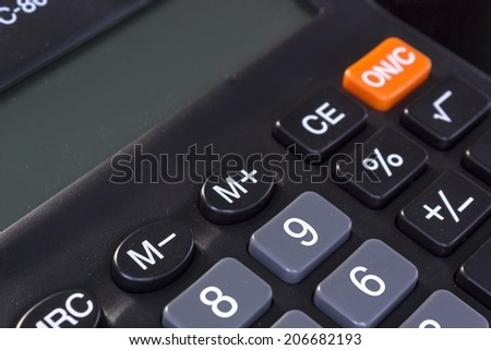 An electronic calculator is a small, portable, often inexpensive electronic device used to perform both basic and complex operations of arithmetic. - stock photo