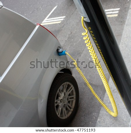 An electronic car chargingin the city - stock photo